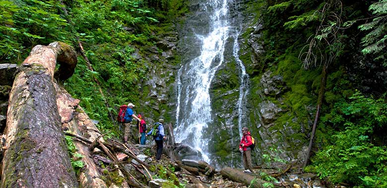 Hikers by a waterfall
