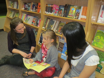 Heather with youth at the public library