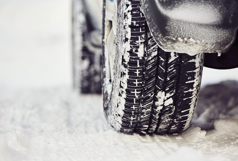 Detail of the tire on winter road