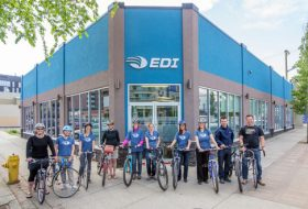 Group of cyclists outside of the place they work