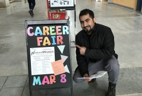 Mosa at a UNBC career fair