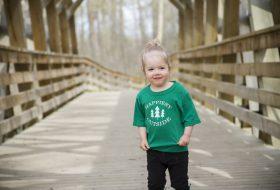 Girl standing on bridge