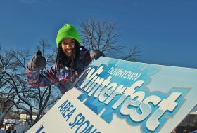 Girl with Winterfest sign