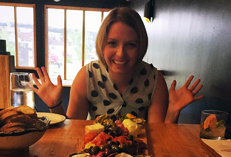 Krystin with her charcuterie board at Betulla Burning