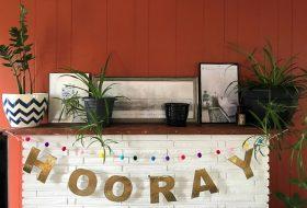 plants on a fireplace mantel