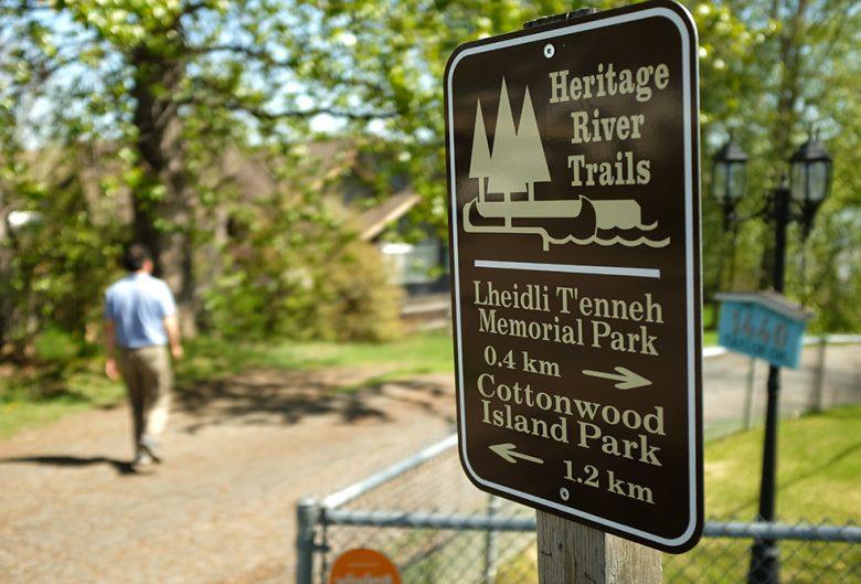 park sign man walking