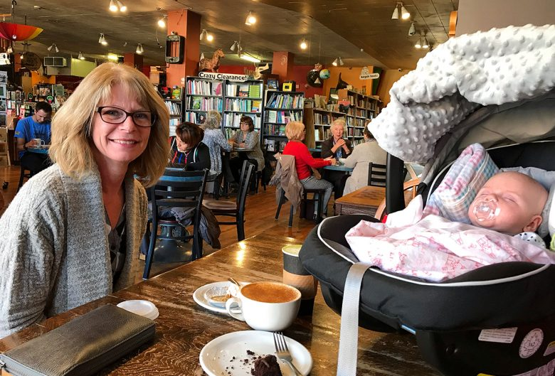 grandma and baby in coffee shop