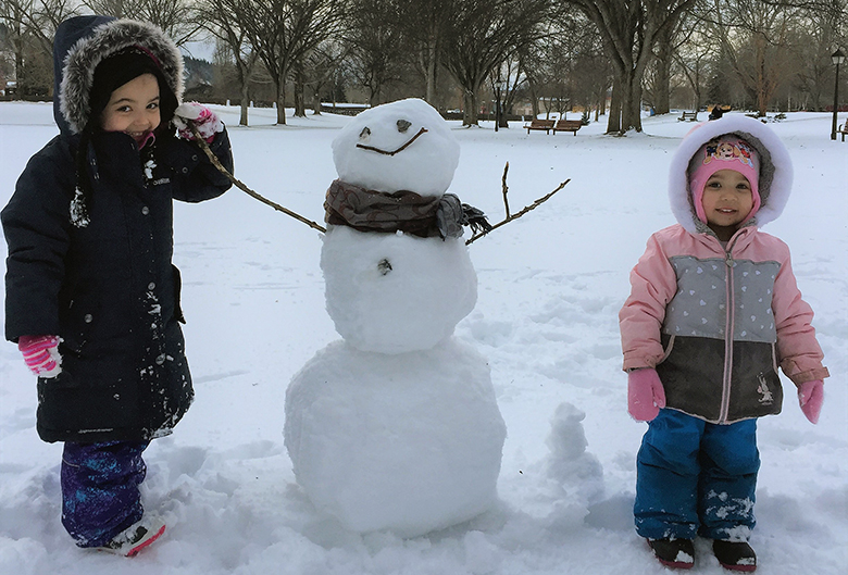 two girls and a snowman