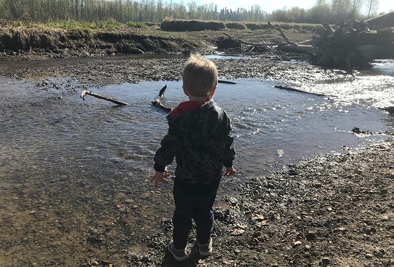 boy standing by water