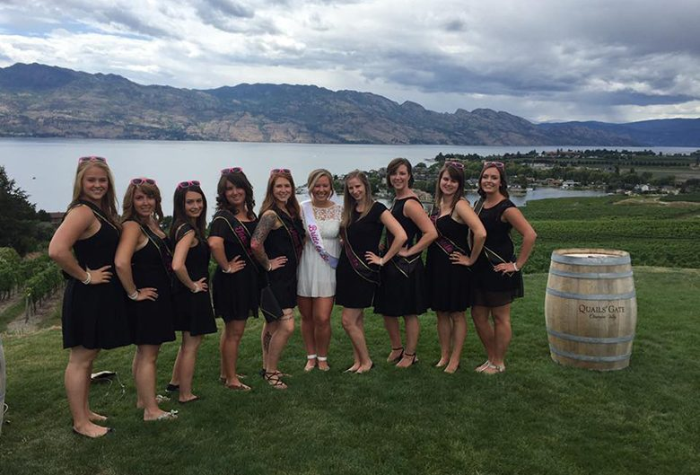 girls in black dresses at a winery