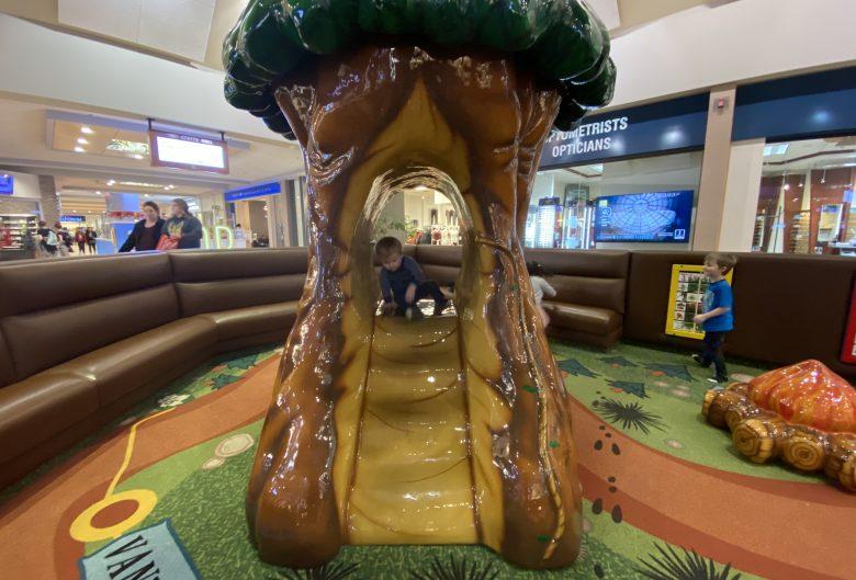 kid playing on slide