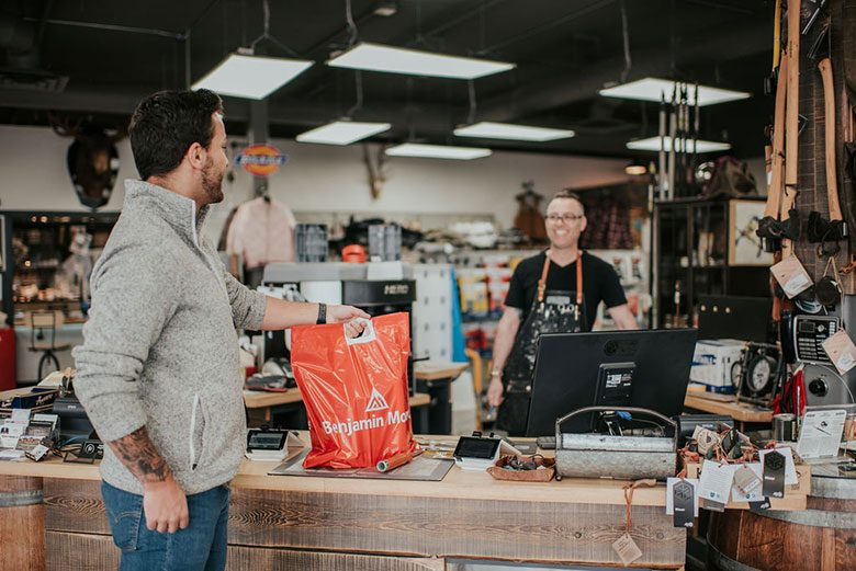 Man and cashier in paint store