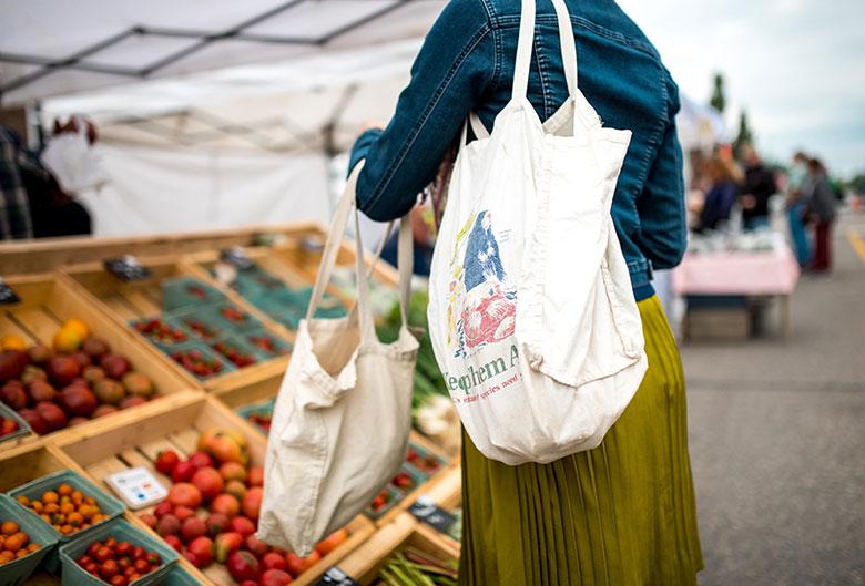 woman shopping at Farmers' Market