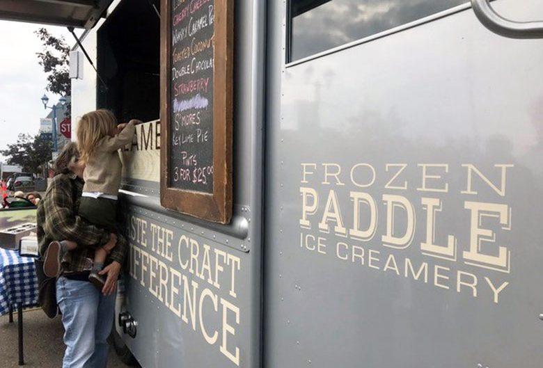 girl getting ice cream from ice cream truck