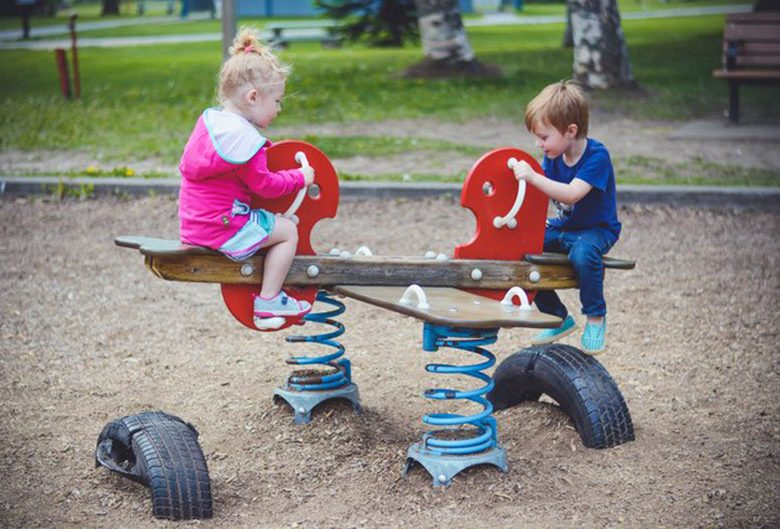 two kids on teeter totter