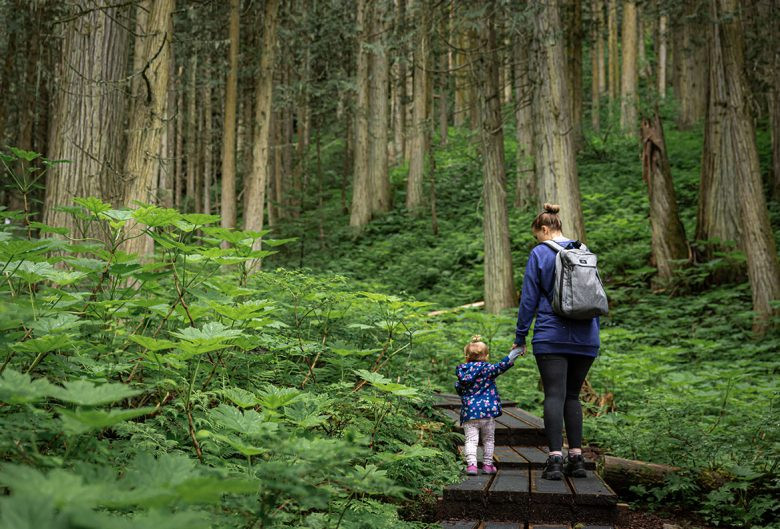 Mom and daughter hiking at the Ancient Forest.