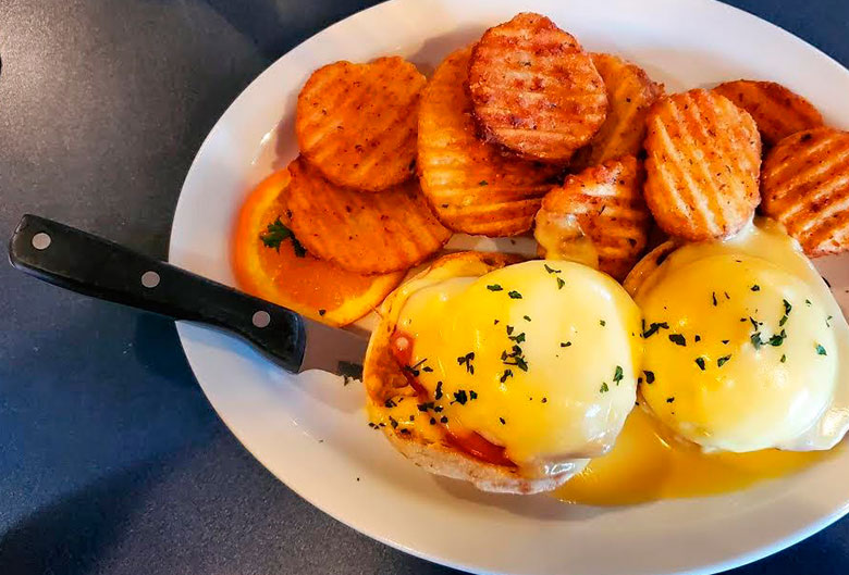 Yolks eggs benedict and hashbrowns