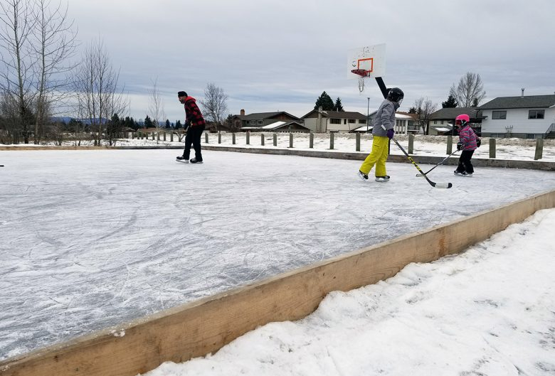 People skating on outdoor rink