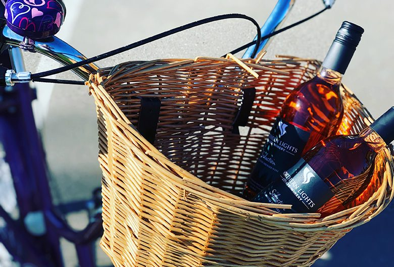 Wine in a bicycle basket.