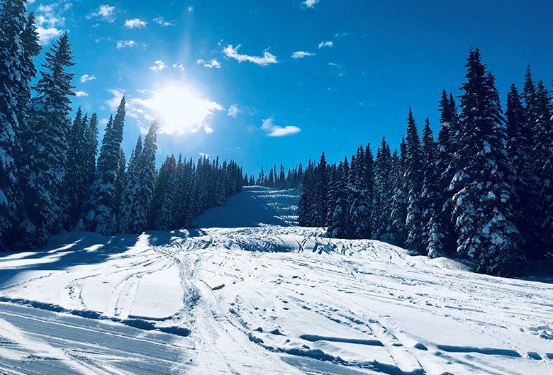 Ski hill under a blue sky.