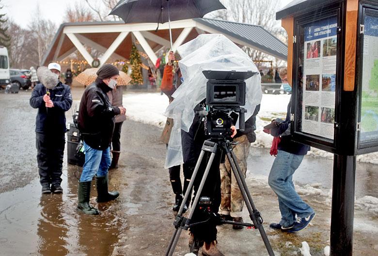 Film crew in a park.
