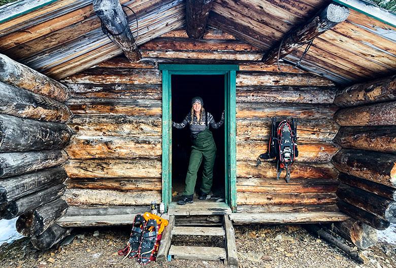Woman standing in cabin doorway