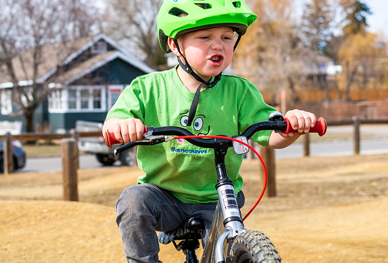 Boy riding bike.