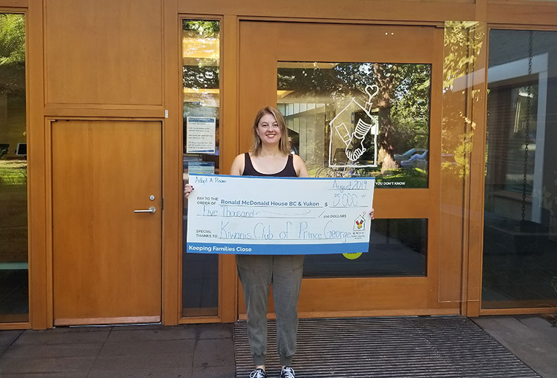 Woman holding a cheque.