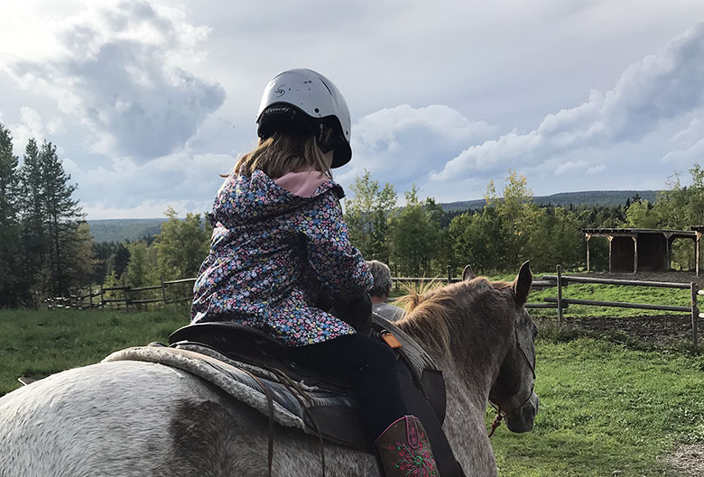 Girl riding pony.