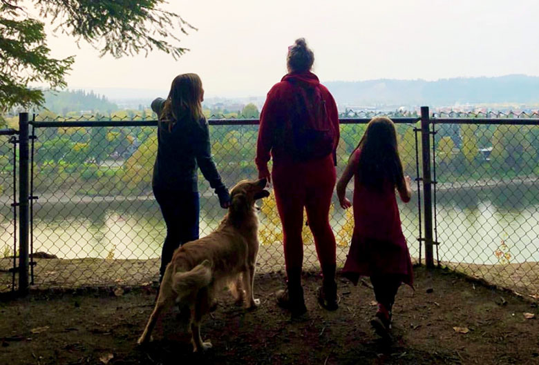 People at LC Gunn Park overlooking Fraser River.