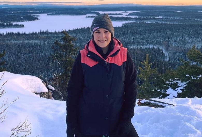 Woman at top of Teapot Mountain.