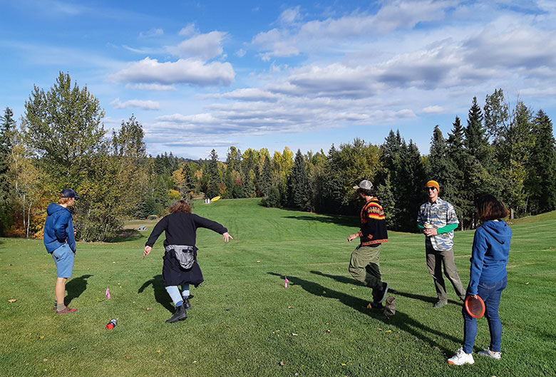 Students playing disc golf