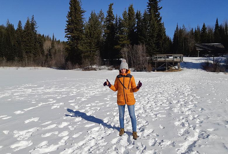 Woman walking on Shane Lake in the winter